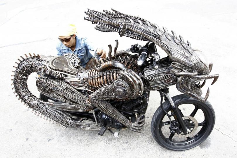 141054-a-worker-checks-the-finishing-on-a-motorcycle-made-from-recycled-mater